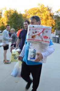 A runner brings paper goods for the Wish List Drive!